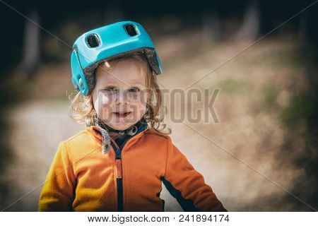 portrait offemale  kid with cycle helmet lomo style picture