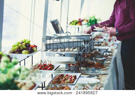 Beautifully Decorated Catering Banquet Table With Variety Of Different Food Snacks And Appetizers On