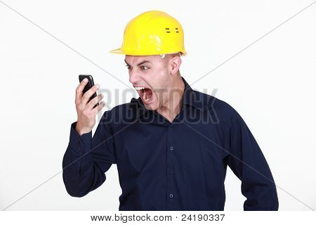 An architect yelling at his phone.