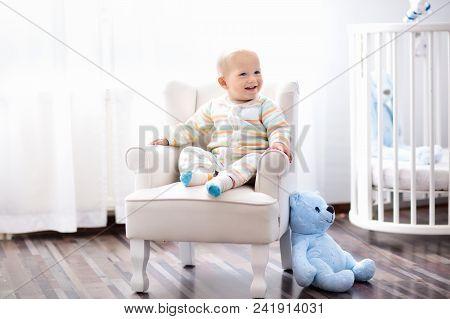 Baby Boy In Bedroom. Kids Room. Bed For Child.