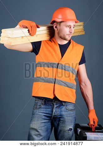 Woodcraft Concept. Carpenter, Woodworker, Labourer, Builder On Busy Face Carries Wooden Beams On Sho