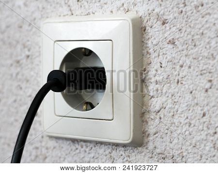 Electric Light Switch And Socket On The Empty Wall, Electrical Power Socket And Plug Switched, Objec