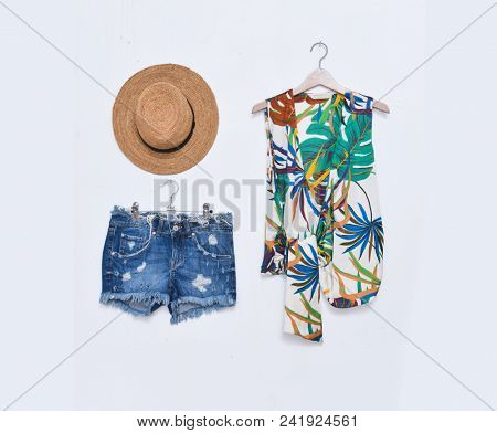 blouse with floral print with fern, with monstera leaf with shoes, shorts jeans ,hat isolated