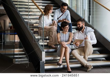 Collaboration And Analysis By Business People Working In Business Office