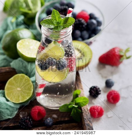 Healthy Refreshing Drink With Lime, Berries And Mint, Infused Detox Water,