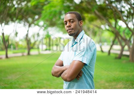 Ambitious Confident Young Black Man With Beard Looking At Camera And Standing In Summer Park. Purpos