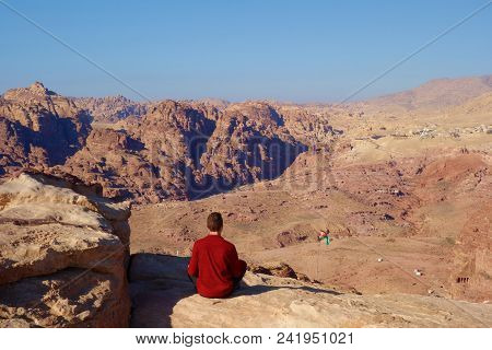 Panoramic View Of Petra With A Young Man And Jordanian Flag From The High Place Of Sacrifice, Jordan