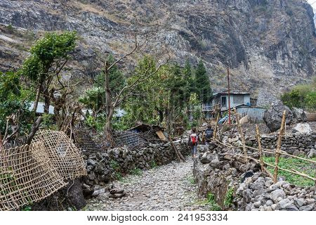A Narrow Street In A Mountain Nepalese Village On A Spring Day.