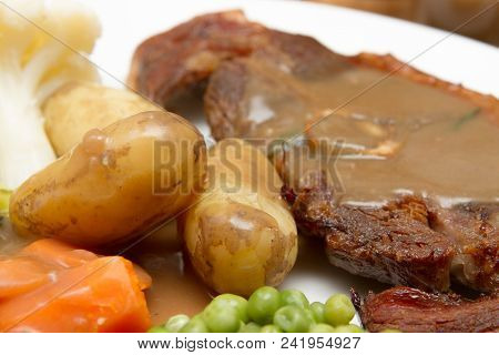 Cooked Barnsley Chop A Plate Of Vegetables With Gravy And A Cooked Barnsley Chop