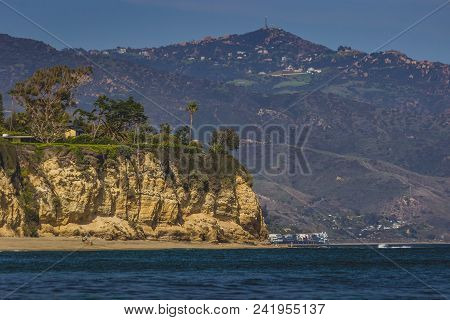 Secluded Dume Cove Beach And Tall Cliffs With Santa Monica Mountains In The Background, Malibu, Cali