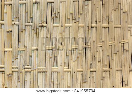 Interesting Texture Of A Woven Bamboo Wall On A Sunny Day.
