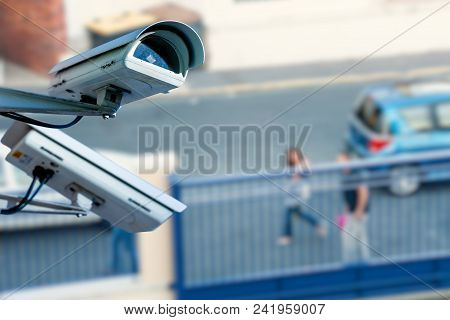Security Cctv Camera Or Surveillance System With Street On Blurry Background