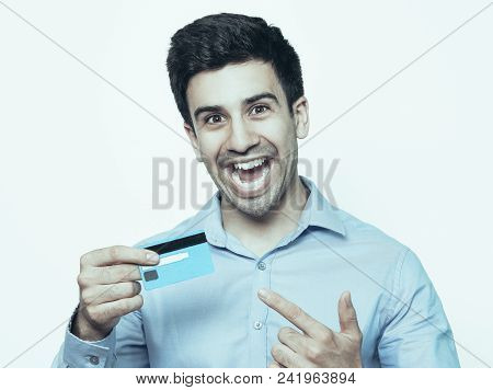 Excited Man Shouting And Pointing At Credit Card. He Getting Salary Or Favourable Credit Conditions.