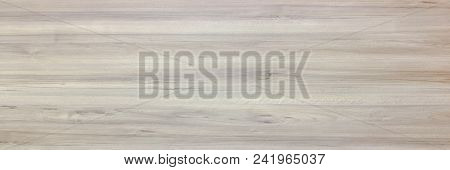 wood texture background, light weathered rustic oak. faded wooden varnished paint showing woodgrain texture. hardwood washed planks pattern table top view poster
