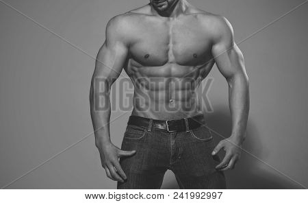 Man With Muscular Body And Torso. Athletic Bodybuilder Man On Grey Background, Copy Space Dieting An
