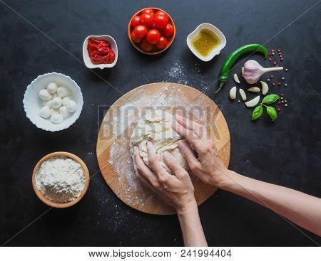 Making Dough By Female Hands At Bakery. Making Italian Pizza Margarita