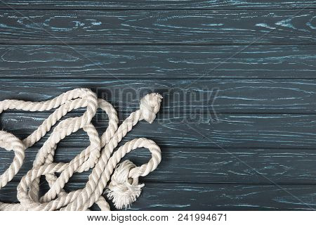 Top View Of Knotted White Nautical Rope On Wooden Planks