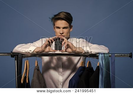 Boy Powered. Issues Face Boys. Man Hold Perfume In Wardrobe On Blue Background. Bachelor In White Sh