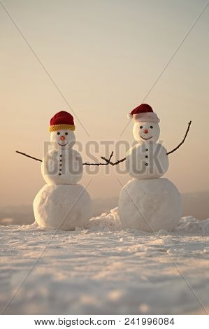 Happy New Year With Snowman. Snowmans Happy Couple. Snowmans Celebration. Santa Claus Hat In Winter.