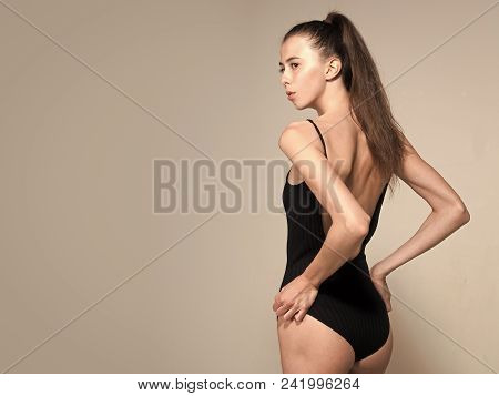 Fashion Model Woman Fece Close Up. Face Woman Wiht Happy Emotion. Beauty And Fashion. Girl In Black