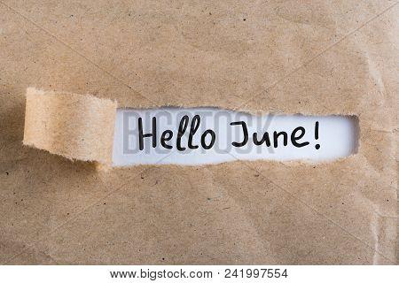 Hello June - Inscription At Brown Torn Envelope. First Summer Day, Calendar Concept.