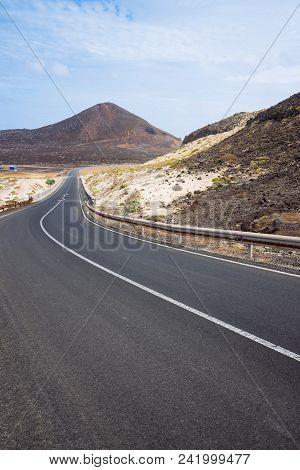 Desolates Straight Road Over A Surreal Landscape With Majestic Volcano Creater In The Distance. Sao