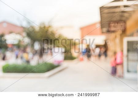 Blurred People Shopping At Outlet In America
