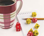 Dices for rpg, tabletop or board games, notebook, pencil and a mug of coffee. poster