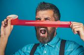 Screaming bearded man glued his nose insulating tape. Casual man in denim shirt with duct tape covering his nose. Emotions, facial expressions - shouting businessman covered by face red adhesive tape. poster