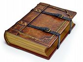Aged leather book with straps and gilded paper edges - laying on the table isolated poster