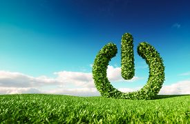 Eco Friendly Renewable Energy Concept. 3d Rendering Of Green Power Button Sign On Fresh Spring Meado