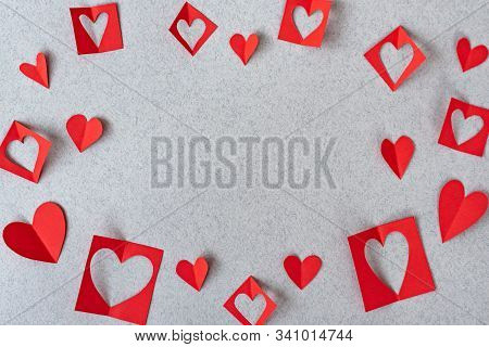 Red Paper Hearts On Grey Textured Paper Backgrounds. Love And Valentine's Day Concept.