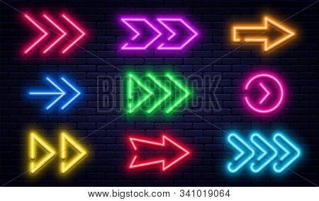 Set Of Glowing Neon Arrows. Glowing Neon Arrow Pointers On Brick Wall Background. Retro Signboard Wi