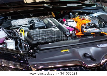 Under The Hood Of A Hybrid Or Electric Car. Detail Of Electric Car Engine.