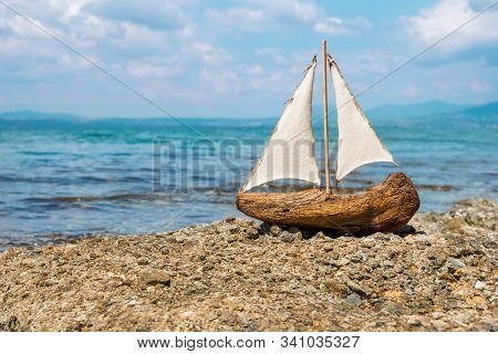 Toy Boat In The Sea Waves. Travel Concept. Sailer On Beautiful Seascape Background. Water Sports Con