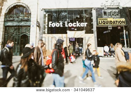 Paris, France - Mar 19, 2019: People Walking In Front Of Foot Locker Store With Protected Closed Sho