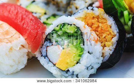 Variety Of Sushi With Cucumber Maki, Sea Cabbage And Salmon Maki. Japanese Sashimi Sushi Rolls With
