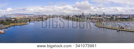 Long Beach modern city skyline, marina and Los Angeles River panorama aerial view in City of Long Beach, Los Angeles County, California CA, USA.