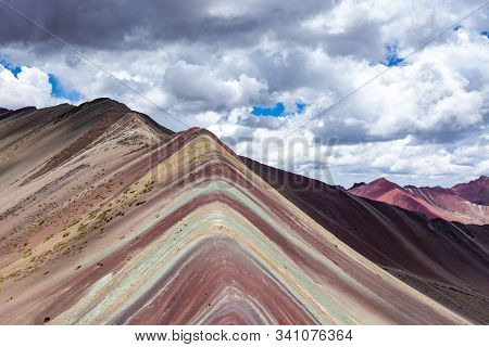 Close-up View Of The Rainbow Mountains Of Peru. Peruvian Andes. Ausangate Mountain. Beautiful Clouds