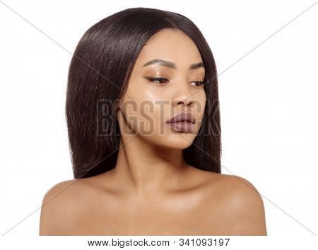 Beauty black skin woman African Ethnic female face. Young african american model with long hair