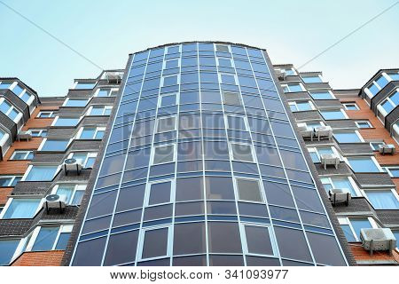 Modern Building With Tinted Windows, Low Angle View. Urban Architecture