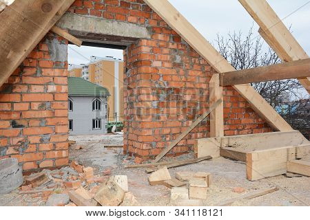 Unfinished Attic House Rooftop Roofing Construction With Trusses, Wooden Beams, Eaves, Timber.  Atti