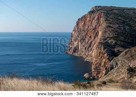 Beautiful Seascape - Rocky Cliffs Breaking Into The Sea At The South Coast Of Crimean Peninsula.