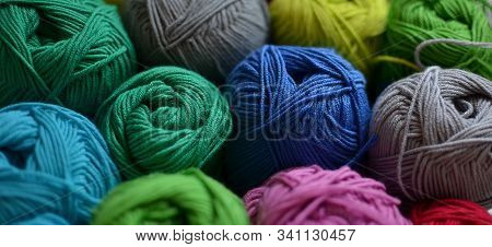 Clews Of Colorful Cotton Yarn Green Blue Grey Header