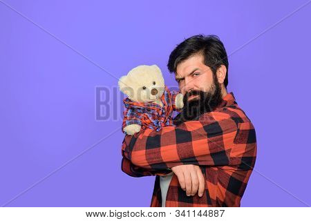 Man With Fluffy Teddy Bear. Gift And Present. Serious Man Hold Teddy Bear Plush Toy. Holiday. Celebr