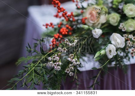 Marriage Flower Composition With Waxflower, Ilex, Eustoma, Pistachio On Table For Winter Wedding Ind