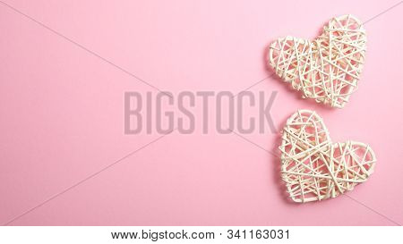 Two Valentine Hearts On Pink Background With Copy Space. Symbols Of Love In Shape Of Heart For Happy