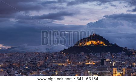 View Of Lycabettus Hill From Areopagus Hill In Central Athens, Greece.