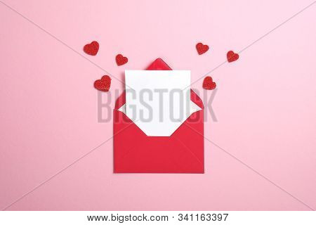 Red Paper Envelope With Blank White Note Mockup Inside And Valentines Hearts On Pink Background. Fla