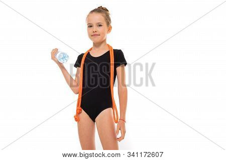 Young Gymnast Child In Sportswear Holds A Water Bottle With A Mock-up On A White Background.